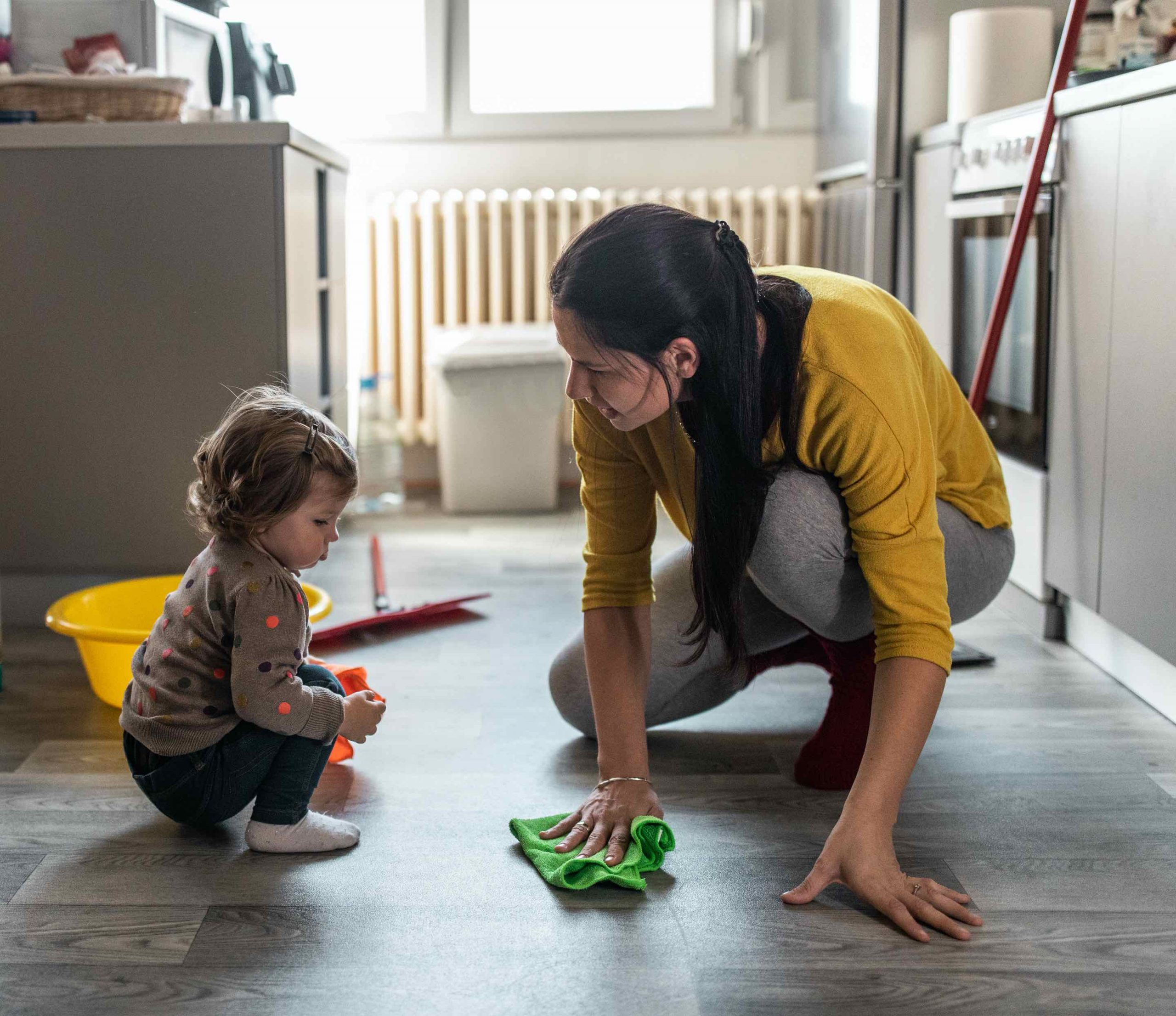 Mother and daughter cleaning floor with Non-Toxic Floor Cleaner